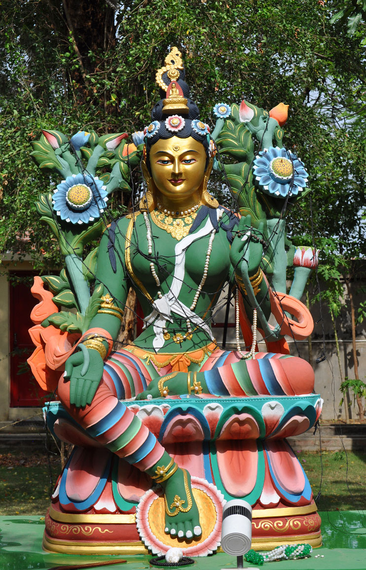 In the back garden, a glorious statue of Arya Tara is a reassuring presence