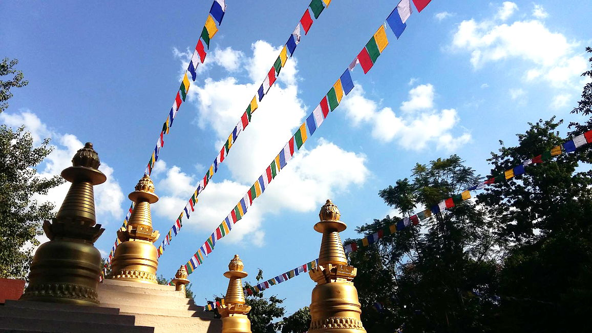 Stupas and prayer flags bless and beautify our grounds