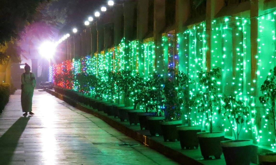 The back wall festooned with lights