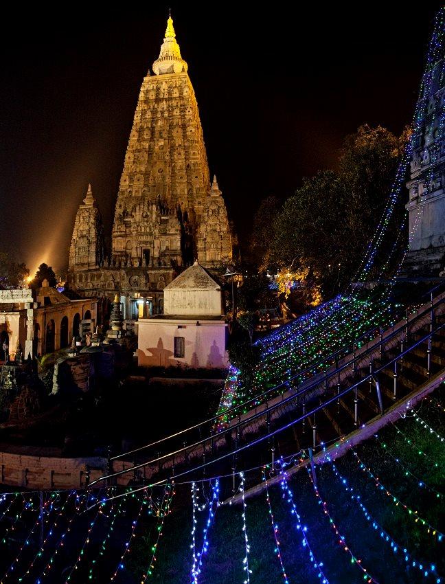 Multiple searchlights shine directly onto the Mahabodhi Stupa