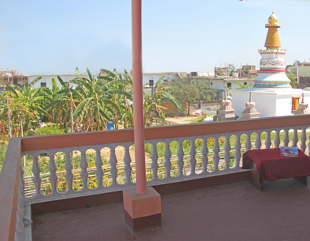 Verandah's view of the stupas, and the garden's many banana plants