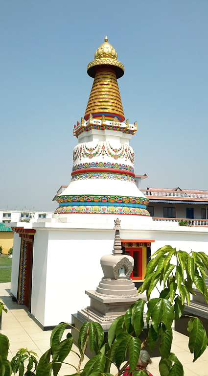 Another view of the stupas, with accommodation block behind