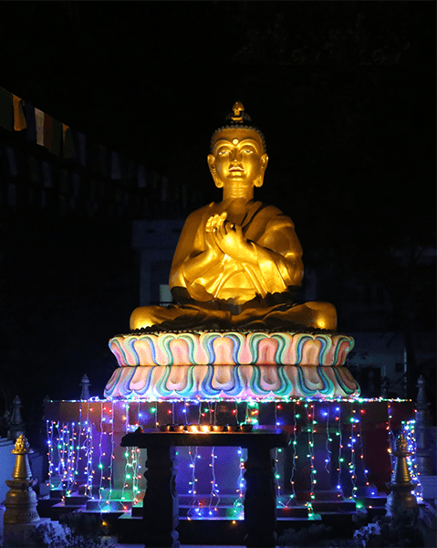 Light offerings to Root Institute's Maitreya Buddha statue during the Festival of Lights & Merit