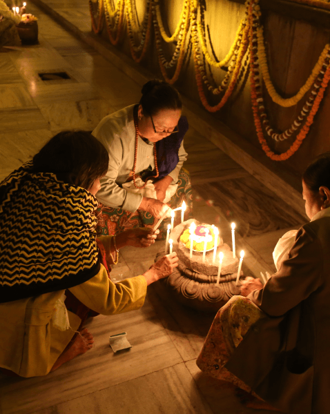 Offering candle lights at Mahabodhi Stupa