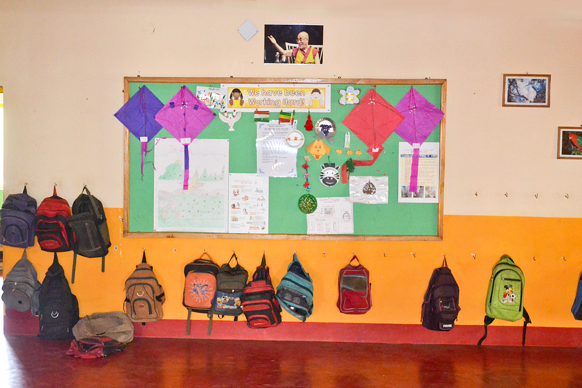 Bags and display of students' work in the hallway
