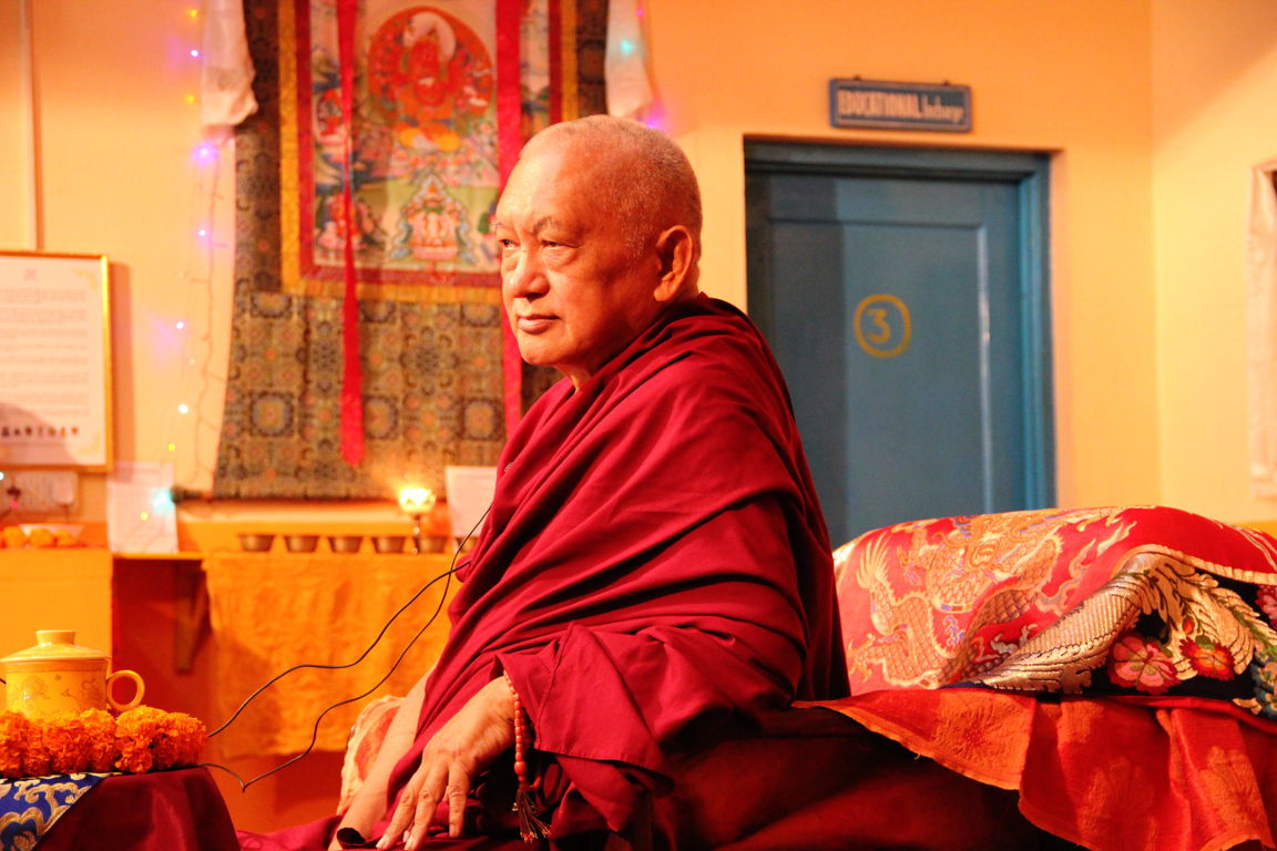 Rinpoche presiding over the assembly