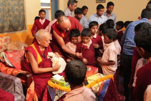 Rinpoche blessing students in turn