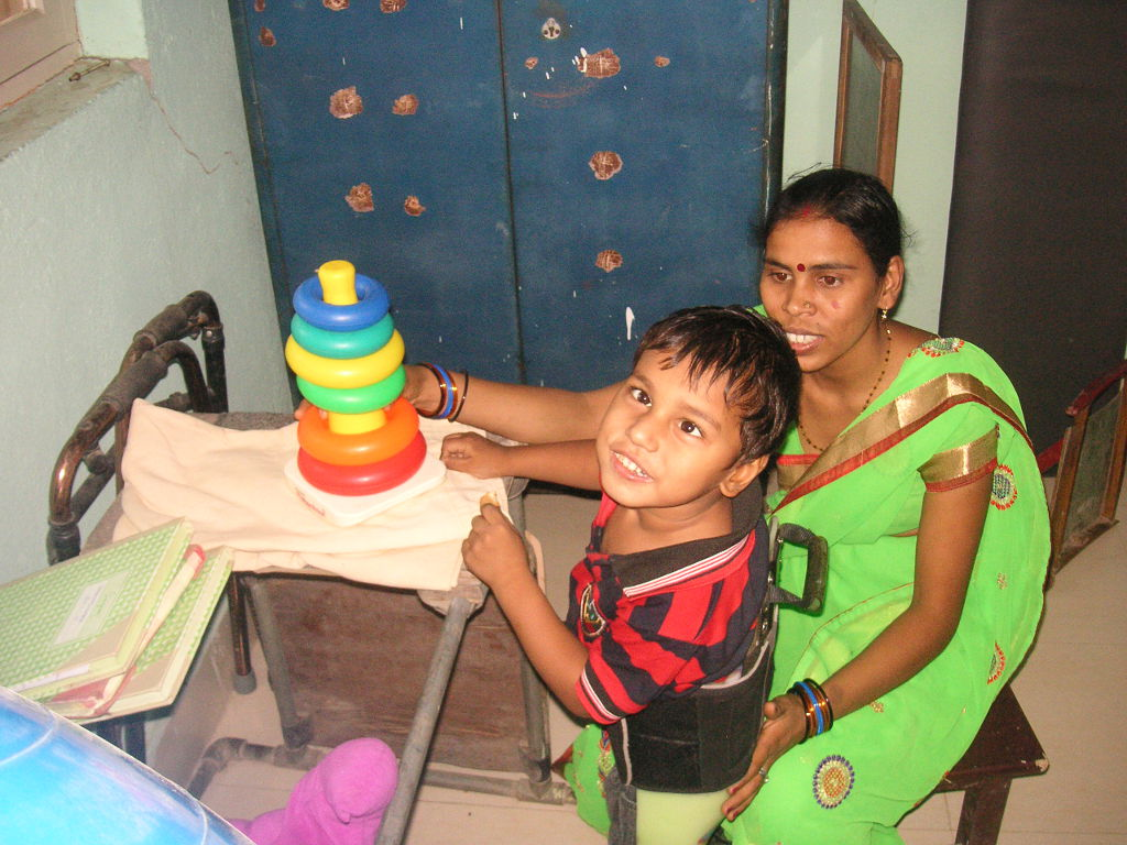 Young patient with disability with his mother