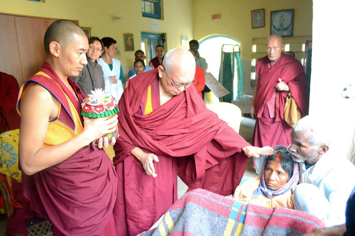 Kyabje Lama Zopa Rinpoche blessing a patient