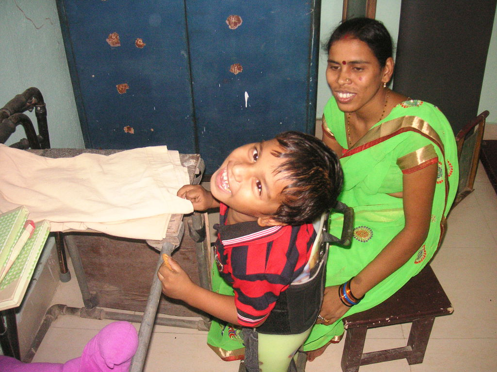 Young patient with disabilty with his mother - 2