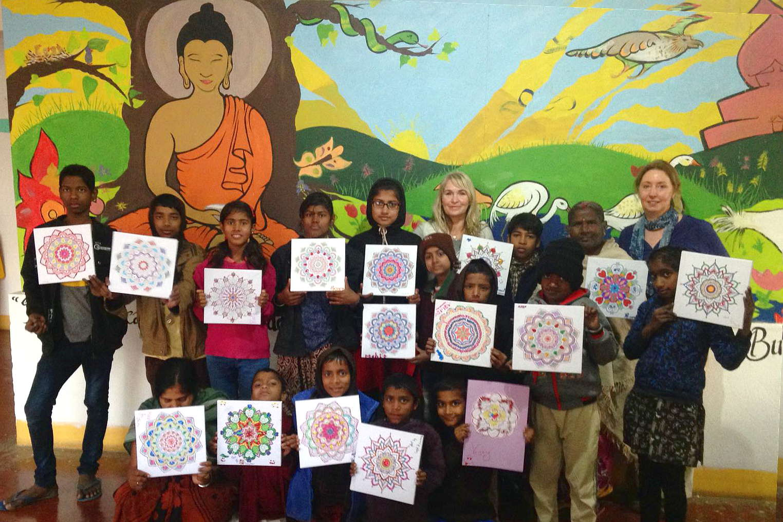 TCP children with the volunteer art therapist after completing their mandala drawings
