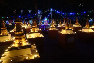 Numerous tea lights offered to stupas in the grounds of Root Institute