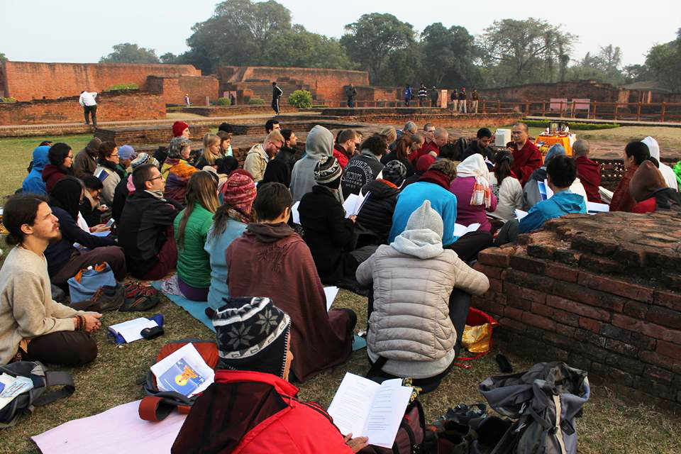 Geshe Damdul leading prayers at Nalanda