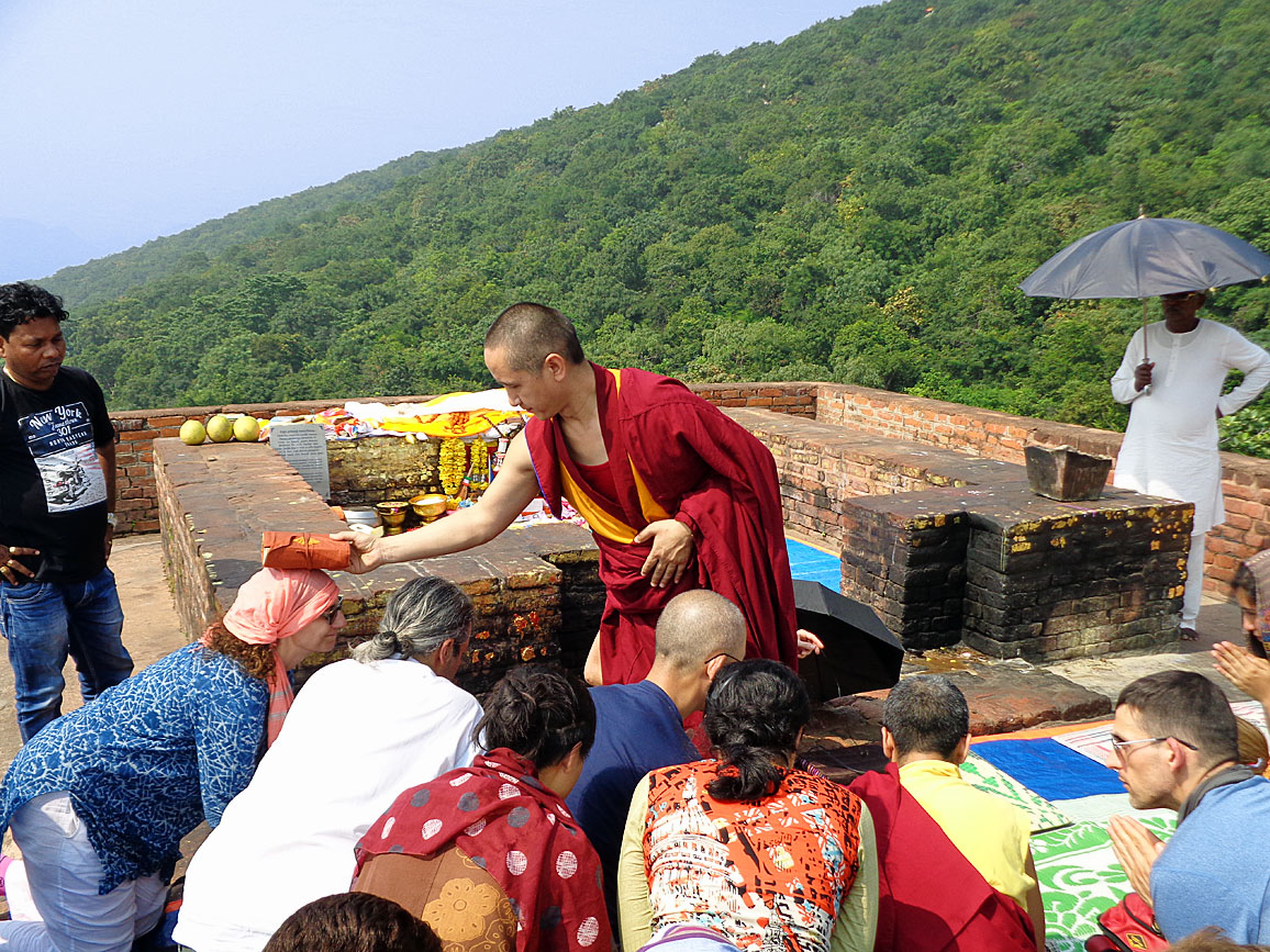 Geshe Tenzin Zopa blessing students at Vulture's Peak, Rajgir, site of many glorious occasions in Lord Buddha's life, such as the Heart Sutra